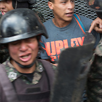 Soldiers brought out for riot duty are not equipped with gas masks and are suffering from the effects of the gas they are using against the protestors. A civilian is captured by the Army. The man was later released.