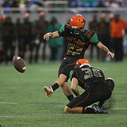 Florida A&M Rattlers place kicker Chase Varnadore (33) kicks the football during the Florida Classic NCAA football game between the FAMU Rattlers and the Bethune Cookman Wildcats at the Florida Citrus bowl on Saturday, November 22, 2014 in Orlando, Florida. (AP Photo/Alex Menendez)