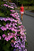 Walking the coastal trail along Stanley Park, Vancouver, British Columbia, Canada.  (model released)