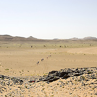 25 March 2007: Participants run across a plateau between Irhs and Khermou during the first stage of  the 22nd Marathon des Sables, a 6 days and 151 miles endurance race with food self sufficiency across the Sahara Desert in Morocco. Each participant must carry his, or her, own backpack containing food, sleeping gear and other material.