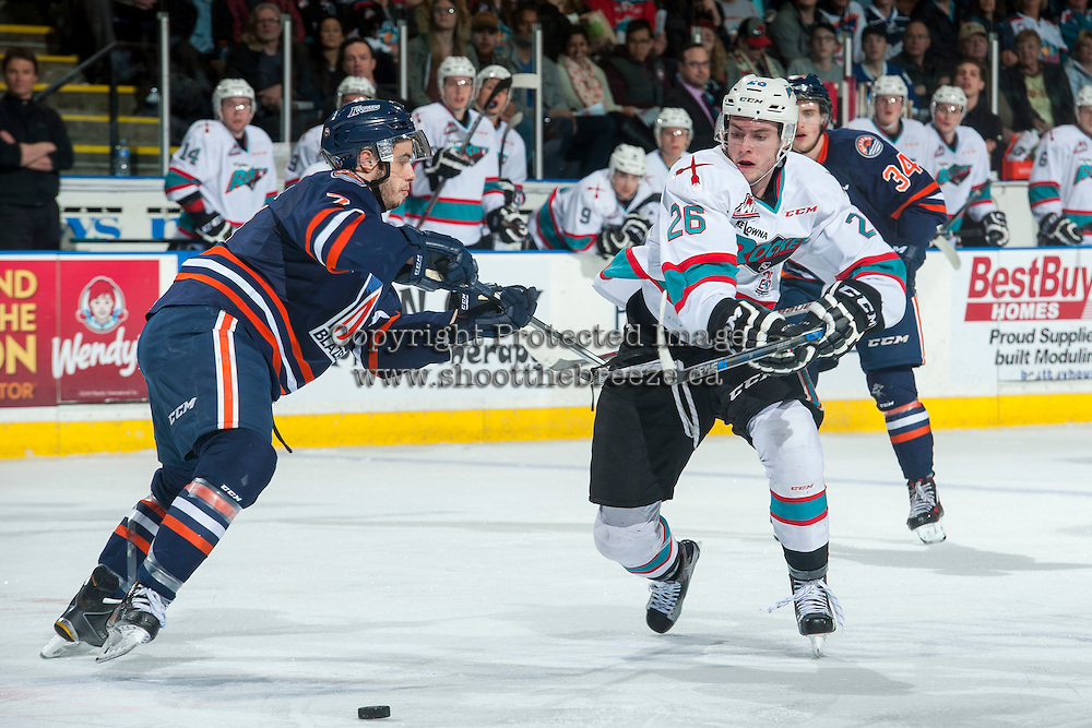 KELOWNA, CANADA - MARCH 26: Gage Quinney #7 of Kamloops Blazers checks Cole Linaker #26 of Kelowna Rockets during second period on March 26, 2016 at Prospera Place in Kelowna, British Columbia, Canada.  (Photo by Marissa Baecker/Shoot the Breeze)  *** Local Caption *** Cole Linaker; Gage Quinney;