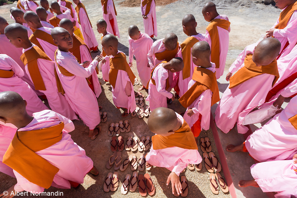 Large group of young Nuns trying to find their slippers, at festival in Kyaunk Da Lole Township, Taunggyi