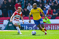 Josh Parker of Charlton Athletic (10) and Herbie Kane of Doncaster Rovers (15) in action during the EFL Sky Bet League 1 play off first leg match between Doncaster Rovers and Charlton Athletic at the Keepmoat Stadium, Doncaster, England on 12 May 2019.