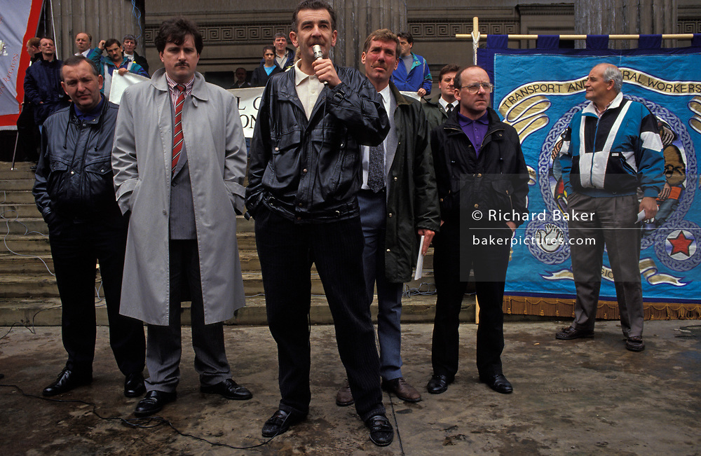 Alongside other union officials, GMB union leader, Ian Lowes speaks to redundant refuse workers in Liverpool during the 1991 local authority strike of 1991, on 14th June 1991, in Liverpool, England. The industrial action against the local authority was a health problem for Liverpool over that summer when streets filled with rubbish. Vermin such as rats ran around and public city parks filled with every kind of refuse and garbage.