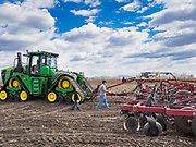 "20 APRIL 2020 - BOUTON, IOWA:  A farmer and his son walk to their tiller while he was tilling a field near Bouton. Iowa farmers are prepping their fields for the 2020 season. The relatively mild winter and dry spring has allowed farmers to get into their fields 1 - 2 weeks earlier than last year. Farmers and agricultural workers are considered ""essential"" workers in Iowa and not subjected to the coronavirus restrictions nonessential workers are. Farmers usually work by themselves, and social distancing guidelines have not impacted them as much as it has workers in Iowa's cities.   PHOTO BY JACK KURTZ"