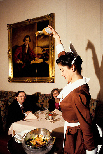 Waitress pours salad dressing at Lawrie's Prime Rib restaurant in Los Angeles California