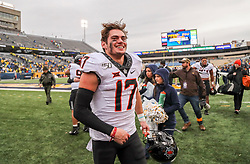 Nov 23, 2019; Morgantown, WV, USA; Oklahoma State Cowboys wide receiver Dillon Stoner (17) celebrates after his team defeated the West Virginia Mountaineers at Mountaineer Field at Milan Puskar Stadium. Mandatory Credit: Ben Queen-USA TODAY Sports
