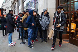 © Licensed to London News Pictures. 28/11/2014. LONDON, UK. People queuing outside a shop on Oxford Street in London to take advantage of Black Friday discounts on Friday, 28 November 2014. Photo credit : Tolga Akmen/LNP