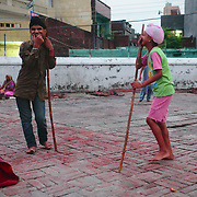 Sikh boys  practicing Gutka, the sikh martial art.