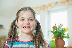 Portrait of girl with braids, smiling
