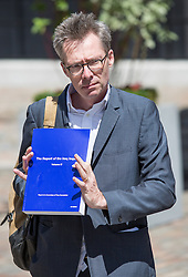© Licensed to London News Pictures. 06/07/2016. London, UK. A man holds a copy of Volume III of The Report of the Iraq Inquiry, conducted by Sir John Chilcot. The Inquiry was predicated to take approximately one year, but has taken seven. The Inquiry is published today. Photo credit : Tom Nicholson/LNP