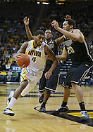 February 27 2013: Iowa Hawkeyes guard/forward Roy Devyn Marble (4) drives past Purdue Boilermakers center A.J. Hammons (20) during the first half of the NCAA basketball game between the Purdue Boilermakers and the Iowa Hawkeyes at Carver-Hawkeye Arena in Iowa City, Iowa on Wednesday, February 27 2013.