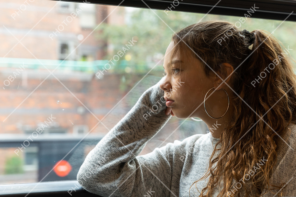 Young girl travels by bus in London, copy space