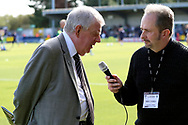 John Motson OBE being interviewed prior to kick off during the EFL Sky Bet League 1 match between AFC Wimbledon and Oxford United at the Cherry Red Records Stadium, Kingston, England on 29 September 2018.