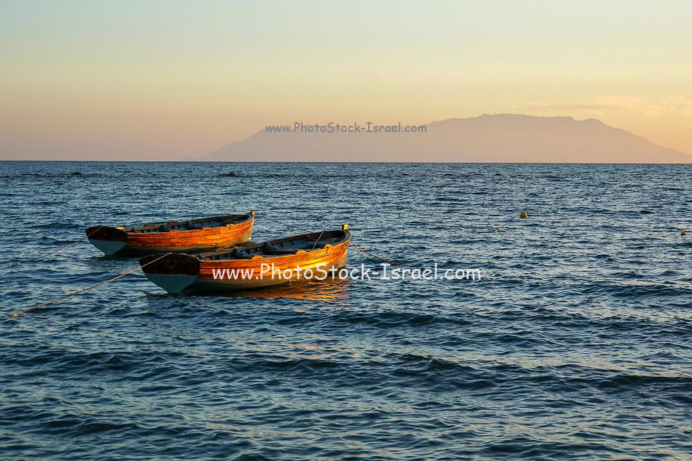 Small fishing boats anchored off shore in the Aegean Sea, Greece