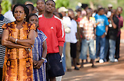 People wait in line to vote at a polling station in Ghana's capital Accra during presidential and parliamentary elections on Sunday December 7, 2008.