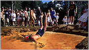 Jul 10, 1999; East Dublin, GA, USA; Mud Pit contestant Eddie Snelgrove's face first dive isn't enough to place him in the final of the game during the Fourth Annual Summer Redneck Games in East Dublin, Ga. Photo by Stephen Morton/ZUMA Press.