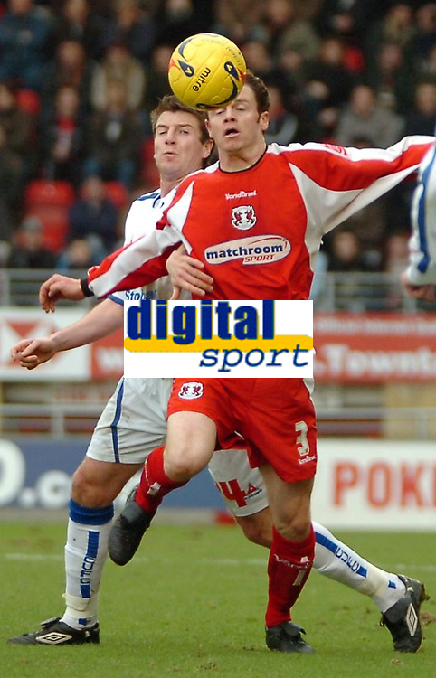 Photo: Ed Godden.<br />Leyton Orient v Carlisle United. Coca Cola League 2. 11/02/2006. <br />Carlisle's Michael Bridges (L) and Matthew Lockwood, challenge for the ball.