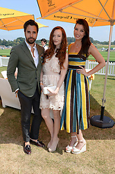 Left to right, DIEGO BIVERO-VOLPE, OLIVIA GRANT and DAISY LOWE at the Veuve Clicquot Gold Cup, Cowdray Park, Midhurst, West Sussex on 21st July 2013.