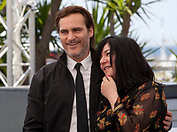 Joaquin Phoenix and director Lynne Ramsay at the You Were Never Really Here film photo call at the 70th Cannes Film Festival Saturday 27th May 2017, Cannes, France. Photo credit: Doreen Kennedy