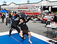 Scott Douglas and Nate Ayotte from LR Vale Tudo demonstrate light Judo Karate and knife techniques during the Belknap County Public Safety Day held at Meadowbrook on Saturday afternoon.  (Karen Bobotas/for the Laconia Daily Sun)