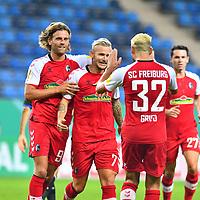 13.09.2020, Carl-Benz-Stadion, Mannheim, GER, DFB-Pokal, 1. Runde, SV Waldhof Mannheim vs. SC Freiburg, <br /> <br /> DFL REGULATIONS PROHIBIT ANY USE OF PHOTOGRAPHS AS IMAGE SEQUENCES AND/OR QUASI-VIDEO.<br /> <br /> im Bild: Jonathan Schmid (#7, SC Freiburg) jubelt ueber sein Tor zum 1:2, mit dabei Lucas Hoeler (SC Freiburg #9), Vincenzo Grifo (SC Freiburg #32)<br /> <br /> Foto © nordphoto / Fabisch