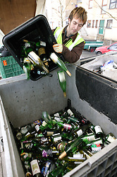 Man recycling glass bottles for Emerge Recycling; Manchester,