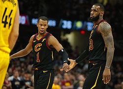 April 18, 2018 - Cleveland, OH, USA - The Cleveland Cavaliers' LeBron James, right, low-fives Rodney Hood after being fouled in the fourth quarter against the Indiana Pacers in Game 2 of a first-round NBA playoff series on Wednesday, April 18, 2018, at the Quicken Loans Arena in Cleveland. The Cavs won, 100-97, to even the series. (Credit Image: © Leah Klafczynski/TNS via ZUMA Wire)