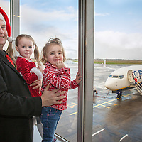 Gerard Rynne with his two daughters Ríona and Caoimhe from Inagh waiting to board their Santa Flight at Shannon Airport