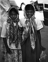 Two young Srik Lankan girls wearing headscarves on their way home from school.