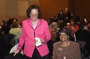 Lonnie Ali greets guests before speaking at the Daughters of Greatness breakfast series Friday Jan. 13, 2012, at the Muhammad Ali Center in Louisville, Ky. Seated to the right of Ali is Charlene Hampton Holloway. (AP Photo/Brian Bohannon)