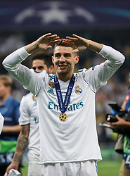 Mateo Kovacic of Real Madrid celebrates with his winner's medal on the pitch as Real Madrid players celebrate winning the UEFA Champions League final football match between Liverpool and Real Madrid at the Olympic Stadium in Kiev, Ukraine on May 26, 2018. - Real Madrid defeated Liverpool 3-1. Photo by Andriy Yurchak / Sportida