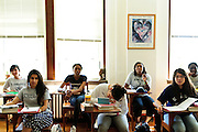Students in Sr. Susan Quaintance's Senior English class listen to her instruction at St. Scholastica Academy. Although the school has officially closed it's doors, a bare bones staff continues to offer a Senior Academy for 26 of it's students. The extension program helps seniors avoid a schools transfer in their final year and a continuation of the school's International Baccalaureate program, a collection of classes not offered at neighboring schools. August 27, 2012 l Brian J. Morowczynski~ViaPhotos...For use in a single edition of Catholic New World Publications, Archdiocese of Chicago. Further use and/or distribution may be negotiated separately. Contact ViaPhotos at 708-602-0449 or email brian@viaphotos.com.