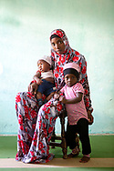 CLIENT: POPULATION ACTION INTERNATIONAL<br /> <br /> A mother and her children after a Muslim women's group discussion about family planning at the Faizina Mosque in Rabai, Kenya.