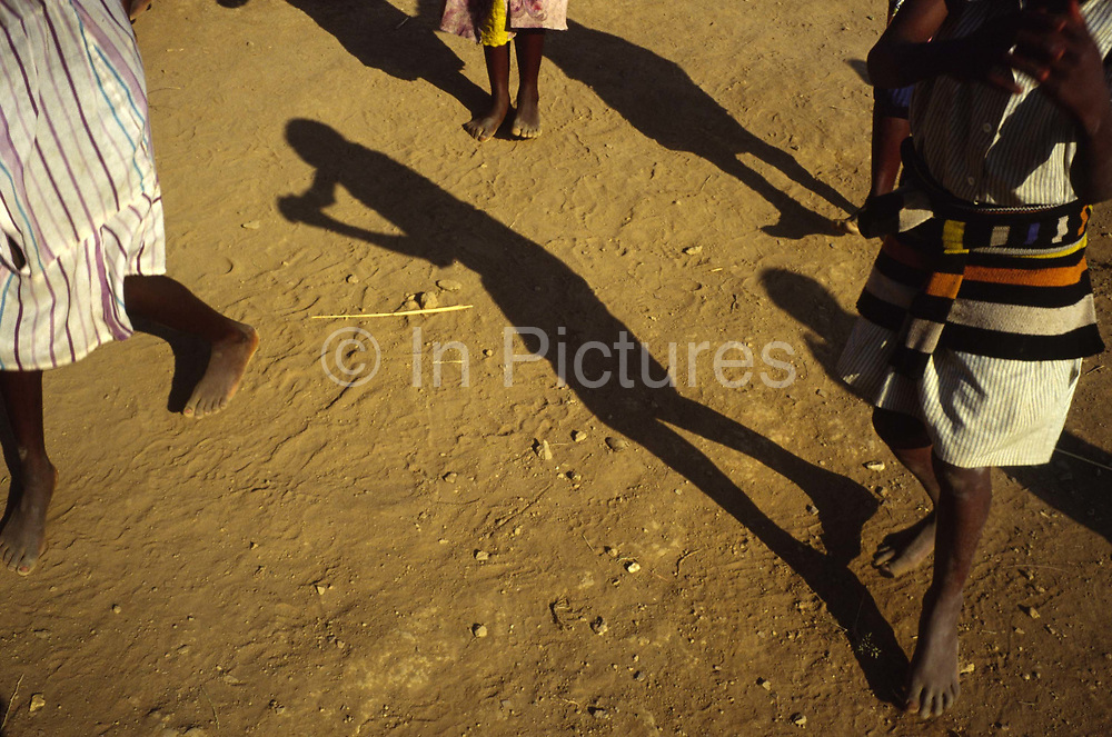"""Children, all war orphans play in the late afternoon sun outside the orphanage called Shalom House.<br /> Shalom House was founded by Marguerite Barankitse (known as the 'Angel of Burundi') in 1994. During the genocide, Barankitse, at great personal risk, managed to save 25 orphans, Hutu, Tutsi and Twa and built a home for them. Currently, she has helped more than 10,000 orphans and separated children who can grow up in an """"extended adopted family"""" in security, education and love."""
