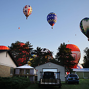 Hot air balloons launch around rural Michigan near Battle Creek during competition in the 20th FAI World Hot Air Ballooning Championships. Battle Creek, Michigan, USA. 23rd August 2012. Photo Tim Clayton