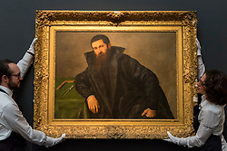"""© Licensed to London News Pictures. 02/12/2016. London, UK. A staff member views """"Portrait of an architect"""" by Lorenzo Lotto (est. GBP 200-300k), at a preview of Sotheby's upcoming Old Masters Evening Sale in New Bond Street. Photo credit : Stephen Chung/LNP"""