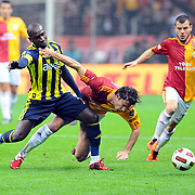 Galatasaray's Lorik CANA (C) and Fenerbahce's Mamadou NIANG (L) during their Turkish superleague soccer derby match Galatasaray between Fenerbahce at the Turk Telekom Arena in Istanbul Turkey on Friday, 18 March 2011. Photo by TURKPIX