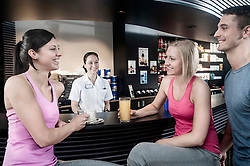 Friends meeting at the bar of a gym