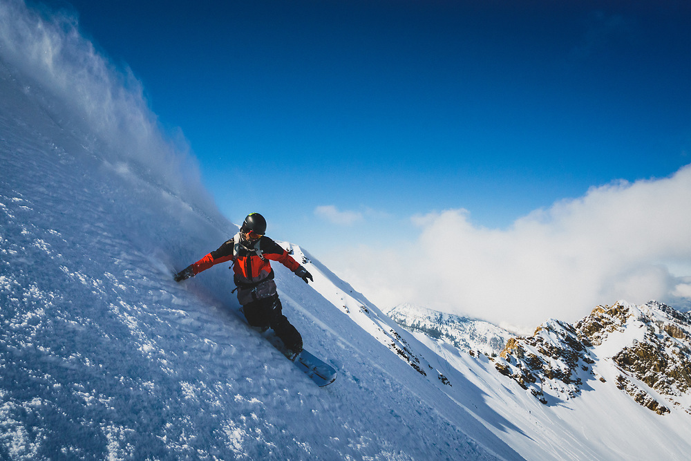 Splitboarder Maxwell Morrill takes advantage of a much needed March snowstorm and surfs the winter landscape of the Wasatch Mountains, Utah.
