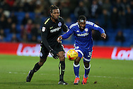 Gaetan Bong of Brighton & Hove Albion (l) challenges Junior Hoilett of Cardiff city. EFL Skybet championship match, Cardiff city v Brighton & Hove Albion at the Cardiff city stadium in Cardiff, South Wales on Saturday 3rd December 2016.<br /> pic by Andrew Orchard, Andrew Orchard sports photography.
