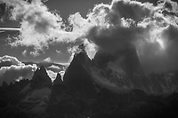Storm clouds clearing over the summit of Mount Fitz Roy, Los Glaciares National Park, Argentina (black and white)