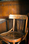 "A wooden chair engraved with a verse from the Koran that states ""With the remembrance of God's name, one's heart feels safe"" in the Gold Star cafe, Cairo, Egypt"