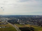 Nederland, Zuid-Holland, Leidschendam, 20-02-2012; zicht op Leidschendam tussen autosnelweg A4 en de Vliet, op het tweede plan Voorburg en Den Haag (rechts), kassen van het Westland en Europoort en Maasvlakte aan de horizon..View on motorway A4 in southern direction. The Hague(r) , greenhouse district and the Europoort (skyline)..copyright foto/photo Siebe Swart