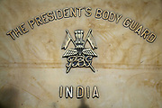 A marble plaque announcing the entrance to the Presidential Bodyguard regiment in New Delhi. The  Presidential Bodyguard or PBG is the Indian Army's preeminent regiment founded in 1773 during the British occupation, this handpicked unit began with a mere 50 men and today stands at 160 soldiers plus 50 support staff. It has a dual role, both as a ceremonial guard for the President of India, with all its finery at important state functions, as well as an elite operational unit for the Indian Army which has seen action in many battle fronts, in particular the on going disputed region of Kashmir.