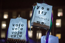 © Licensed to London News Pictures. 06/02/2018. Bristol, UK.  March in Bristol to celebrate the 100th anniversary of women getting the vote in the UK in 1918, following the campaign by the Suffragettes. Hundreds of women and some men marched down Park Street to College Green for a rally and entertainment on the evening of 06 February 2018.  Photo credit: Simon Chapman/LNP