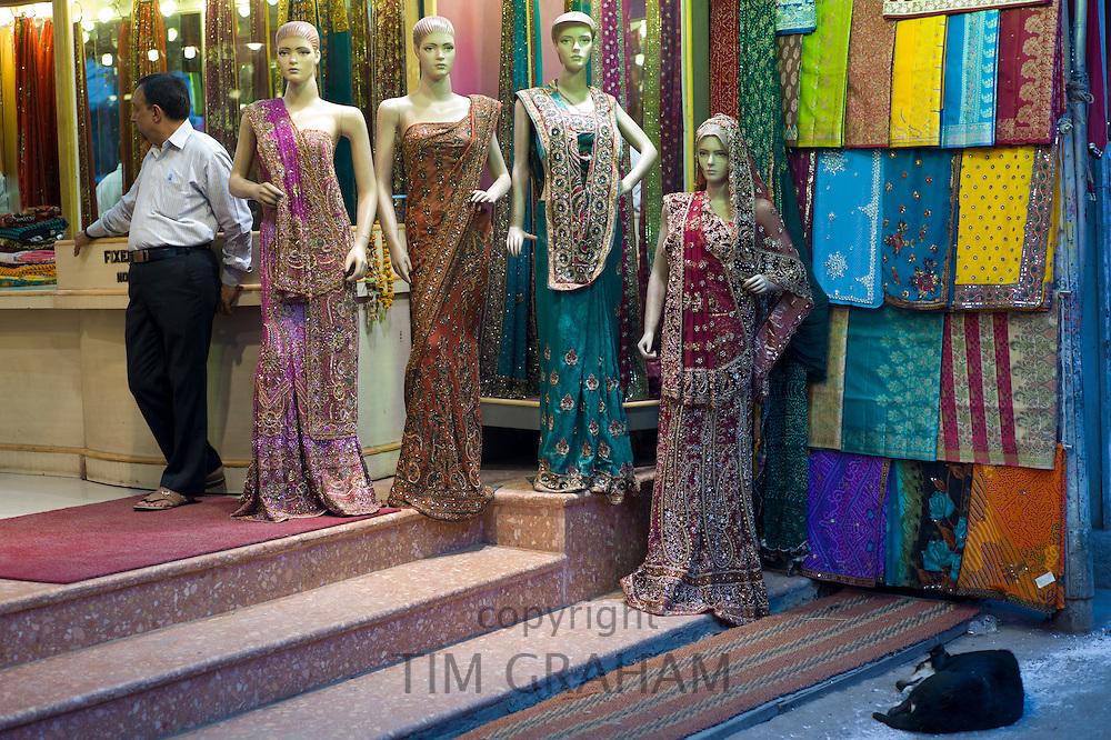 Sari clothes shop in city of Varanasi, Benares, Northern India