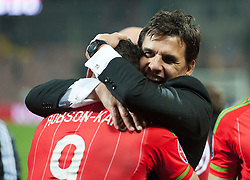 ZENICA, BOSNIA & HERZEGOVINA - Saturday, October 10, 2015: Wales manager Chris Coleman and Hal Robson-Kanu celebrate after securing a place at next years Euro Championships after the Bosnia & Herzegovina vs Wales match at the Stadion Bilino Polje during the UEFA Euro 2016 qualifying Group B match. (Pic by Peter Powell/Propaganda)