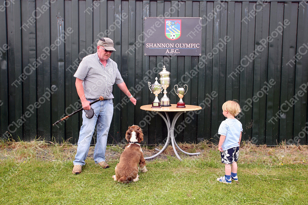 Pictured at the FAI summer camp on Thursday 14th July 2011 were Tom Hogan with Rasher the dog and his grandson Adam Ryan eyeing up the trophies.<br /> Emma Jervis / Press 22