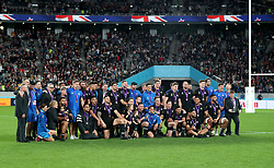 New Zealand players celebrate with their medals after winning the 2019 Rugby World Cup bronze final match at Tokyo Stadium.